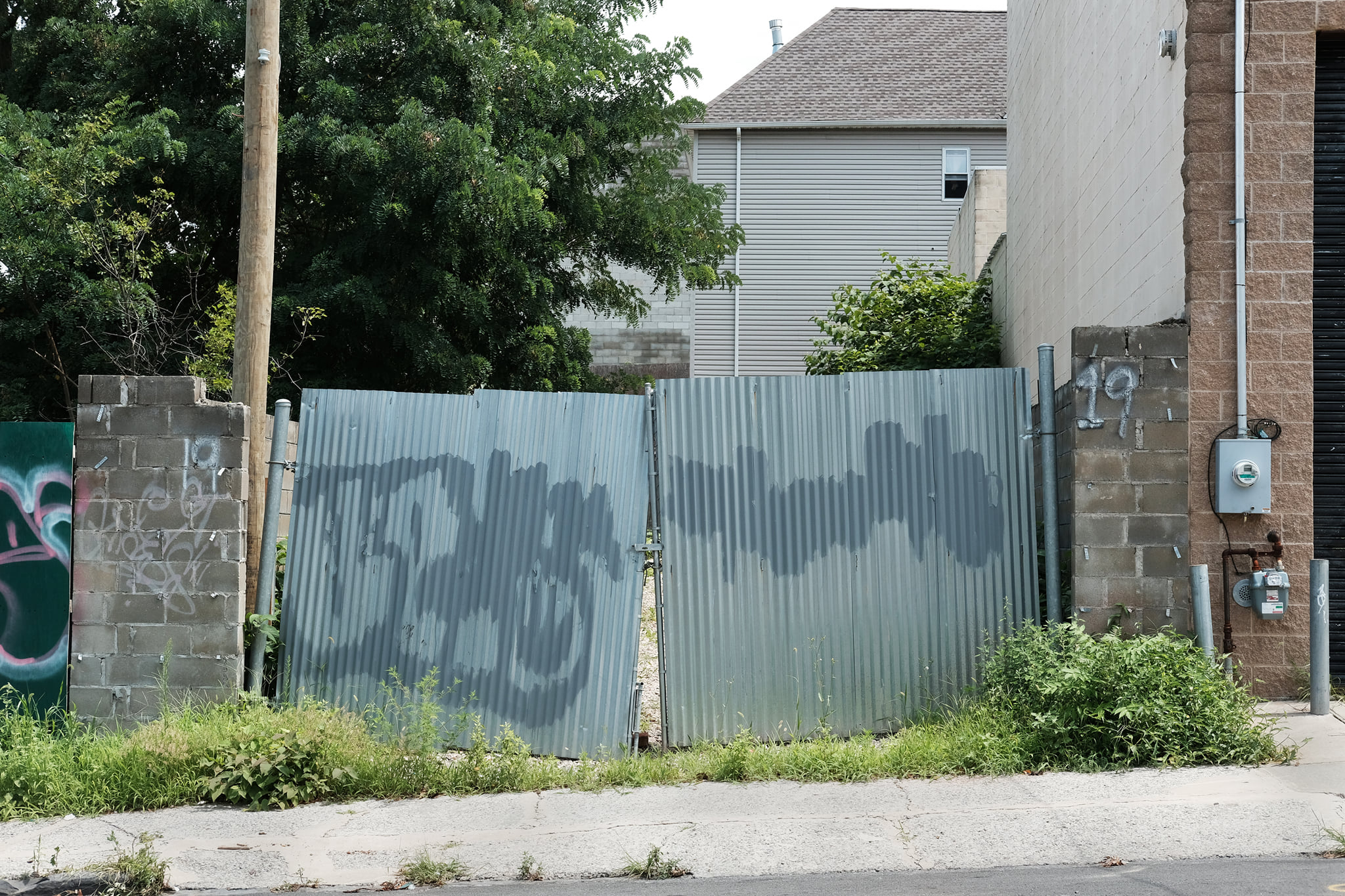 4 Corrugated Metal Gates and Two Meters